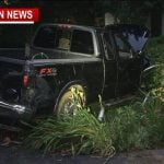 Truck drives through fence nearly misses house